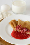 Pancakes and ingredients. Pancakes with jam for breakfast Stock Images