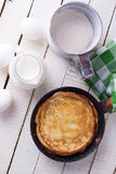 Pancakes and ingredients for it Stock Images