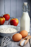 Pancakes ingredients. Food ingredients to make american style pancakes with apples including flour, milk, eggs Royalty Free Stock Image