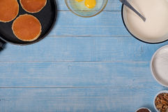 Pancakes with ingredients for making the dough for pancakes Royalty Free Stock Image