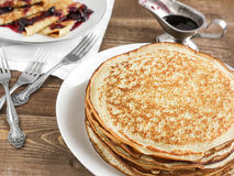 Pancakes with jam. Pancakes with black currant jam royalty free stock photo