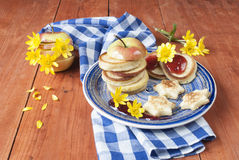 Pancakes with jam. And apple for breakfast, pastries and sweets Stock Images