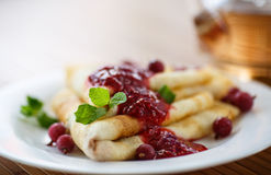 Pancakes with jam and berries Stock Photography