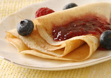 Pancakes with jam and berries Stock Image