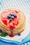 Pancakes with jam Royalty Free Stock Photos