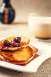 Pancakes with jam and coffee on burlap background Royalty Free Stock Photos