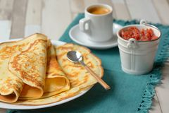 Pancakes with jam and Espresso royalty free stock image