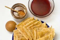 Pancakes, jam and honey Royalty Free Stock Photos