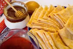 Pancakes, jam and honey Royalty Free Stock Images