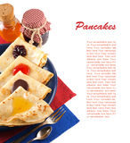 Pancakes with jam, honey and chocolate. Stock Images