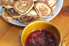 Pancakes and jam. stock photography