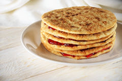 Pancakes with jam on a plate. Closeup Stock Image