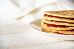 Pancakes with jam on a plate. Closeup Stock Photography