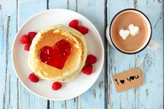 Pancakes, hot chocolate and I Love You tag over blue wood Stock Image