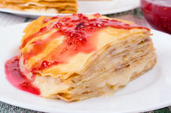 Pancakes with jam. Pancakes smeared with vanilla cream and topped with raspberry jam Royalty Free Stock Photography