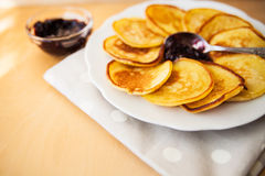 Pancakes with jam and spoon Royalty Free Stock Photos