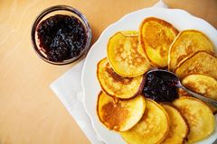 Pancakes with jam and spoon Royalty Free Stock Images