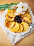Pancakes with jam and spoon Stock Images