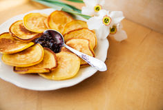Pancakes with jam and spoon Royalty Free Stock Image