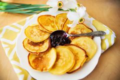 Pancakes with jam and spoon Stock Image