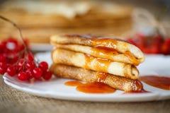 Pancakes with jam viburnum Royalty Free Stock Photography