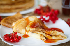 Pancakes with jam viburnum Stock Image