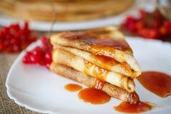 Pancakes with jam viburnum Royalty Free Stock Photos