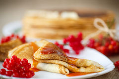 Pancakes with jam viburnum Stock Images