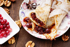 Pancakes with jam, walnuts and cranberries Royalty Free Stock Image