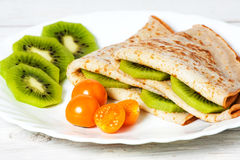 Pancakes with a kiwi and fizalisy. Pancakes with a kiwi and  fizalisy Stock Photo