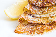 Pancakes with lemon Stock Images