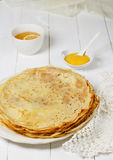 Pancakes with lemon jam. And cup of tee Royalty Free Stock Photo