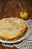 Pancakes. With lemon jam on plate on wooden table Stock Photography