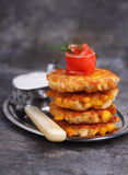 Pancakes made from corn and fork. On gray background royalty free stock photos