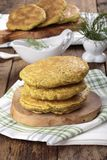 Pancakes made from corn flour with spinach and herbs royalty free stock photography