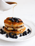Pancakes with maple syrup. On the plate Stock Photos