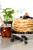 Pancakes with maple syrup and blueberry. Studio shoot of Pancakes with maple syrup and blueberry royalty free stock photo