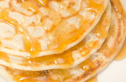Pancakes with maple syrup. Closeup pancakes with maple syrup royalty free stock photography