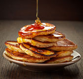 Pancakes with maple syrup. On plate Stock Photo