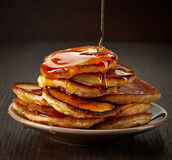Pancakes with maple syrup. On plate Royalty Free Stock Photography