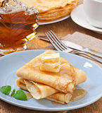 Pancakes with maple syrup Royalty Free Stock Images