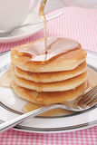 Pancakes and maple syrup. Pouring maple syrup on buttermilk pancakes Stock Images