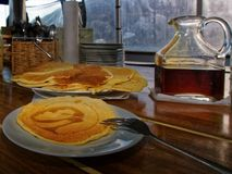 Pancakes and maple syrup. Pancakes steaming and maple syrup, a yummie breakfast royalty free stock images