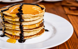 Pancakes with maple syrup. Traditional american breakfast pancakes with maple syrup and chocolate stock images