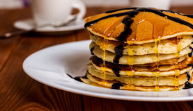 Pancakes with maple syrup. Traditional american breakfast pancakes with maple syrup and chocolate royalty free stock images