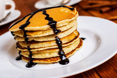 Pancakes with maple syrup. Traditional american breakfast pancakes with maple syrup and chocolate royalty free stock photo