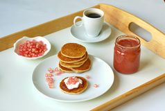Pancakes with marmelade, pomegranate, cottage cheese and coffee Stock Photo