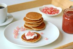 Pancakes with marmelade, pomegranate, cottage cheese and coffee Royalty Free Stock Photo