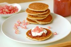 Pancakes with marmelade, pomegranate, cottage cheese and coffee Stock Photos