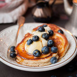 Pancakes with Mascarpone and Blueberries. Fluffy Wholemeal Pancakes with Mascarpone and Fresh Blueberries, Burning Candle, square Royalty Free Stock Image